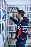 Student reading book in library Study lessons for exam.  Royalty Free Stock Images