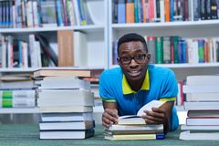 Student reading book in library Study lessons for exam.  Stock Photos