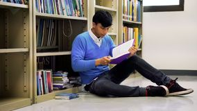 Student reading book in library. He was sleepy when he reading a book stock video