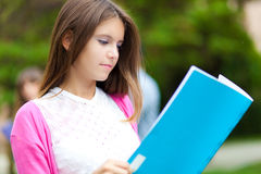 Student reading a book at the park Stock Images
