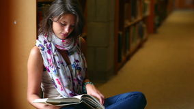 Student reading a book sitting by a window stock video footage