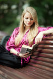 Student reading book in summer park. Royalty Free Stock Photo