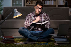 The student reading books preparing for exams. Student reading books preparing for exams Royalty Free Stock Photo