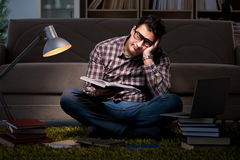 The student reading books preparing for exams. Student reading books preparing for exams Royalty Free Stock Images