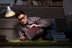 The student reading books preparing for exams. Student reading books preparing for exams Stock Image