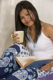 Student reading and drinking coffee Stock Images