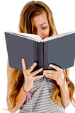 Student reading her notebook Stock Images