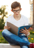 Student reading his notebook Stock Image