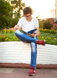 Student reading his notebook Royalty Free Stock Images