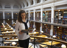 Student reading in library upstairs Royalty Free Stock Photos