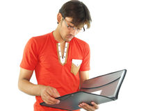 Student reading notes. A male student reading notes form a folder, white background Stock Photography