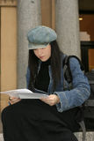 Student reading papers Royalty Free Stock Image