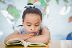 Student reading from a school book Royalty Free Stock Photography