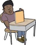 Student Reading am Schreibtisch Stockfoto