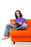 Student reading  on sofa Stock Photography