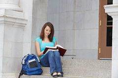 Student reading on steps Royalty Free Stock Photography