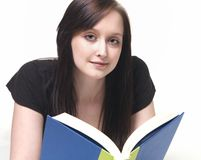 Student reading a textbook Royalty Free Stock Photography