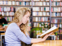 student reads the book in library Royalty Free Stock Photos
