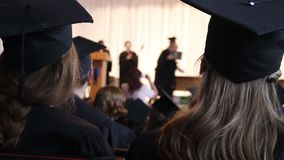 Student receiving higher education certificate from dean, graduation ceremony. Stock footage stock video