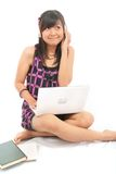 Student relaxing. On bed with laptop Royalty Free Stock Images