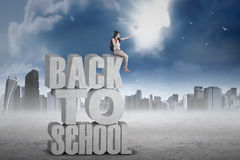 Student releases doves from text of back to school Stock Images
