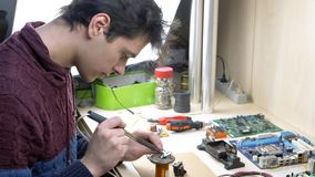 Student repair of electronic devices in electronics workshop. Student repair of electronic devices, tin soldering parts in electronics workshop stock video