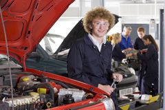 Student repairing car in automotive vocational school Stock Image