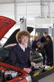Student repairing car in automotive vocational school Stock Photos