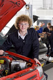 Student repairing car in automotive vocational school Royalty Free Stock Photography