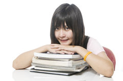 Student resting her head on her books Stock Images