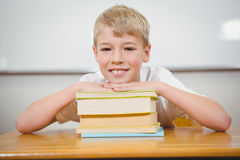 Student resting thie head upon some books. At the elementary school Stock Photography