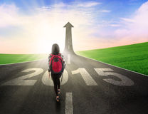 Student on the road with number 2015 Royalty Free Stock Photography