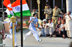 Student Running with the Indian Flag. At the ceremonial of the border between India and Pakistan stock photo