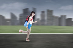 Student running on tracks 1 Royalty Free Stock Photos