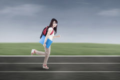 Student running on tracks Stock Photos
