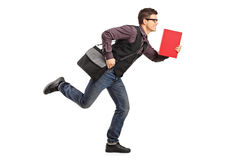 Student in rush running with notebook. Full length portrait of a student in rush running with notebook on white background Stock Image