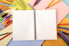 Student's desk with blank notebook Royalty Free Stock Photo