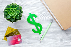 Student`s desk with dollar sign for fee-paying education set gray background top view mock up Stock Photos