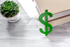 Student`s desk with dollar sign for fee-paying education set gray background Stock Image