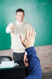 Student's Hand With Professor Pointing At Him In Royalty Free Stock Images