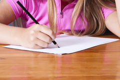 Student's hand writing Royalty Free Stock Photos