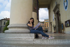 Student`s resting. Student rests on church steps Royalty Free Stock Photography