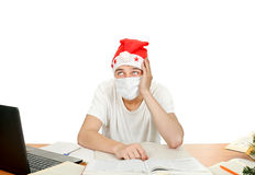 Student in santa's hat and flu mask Stock Images