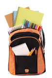 Student school bag full with books, pencils, crayons, isolated on white background Royalty Free Stock Image