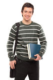 Student with a school bag holding books. A student with a school bag holding books isolated on white background Stock Images