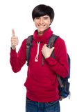 Student with school bag and thumb up Royalty Free Stock Photography
