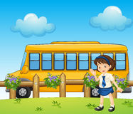 A student and the school bus. Illustration of a student and the school bus Stock Photo