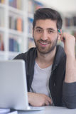 Student in school library using laptop for research Royalty Free Stock Photography