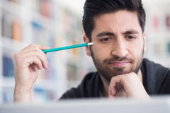Student in school library using laptop for research Stock Photo