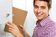 Student by school locker Royalty Free Stock Photos